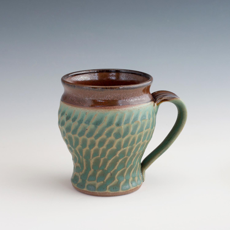 green-carved-mug