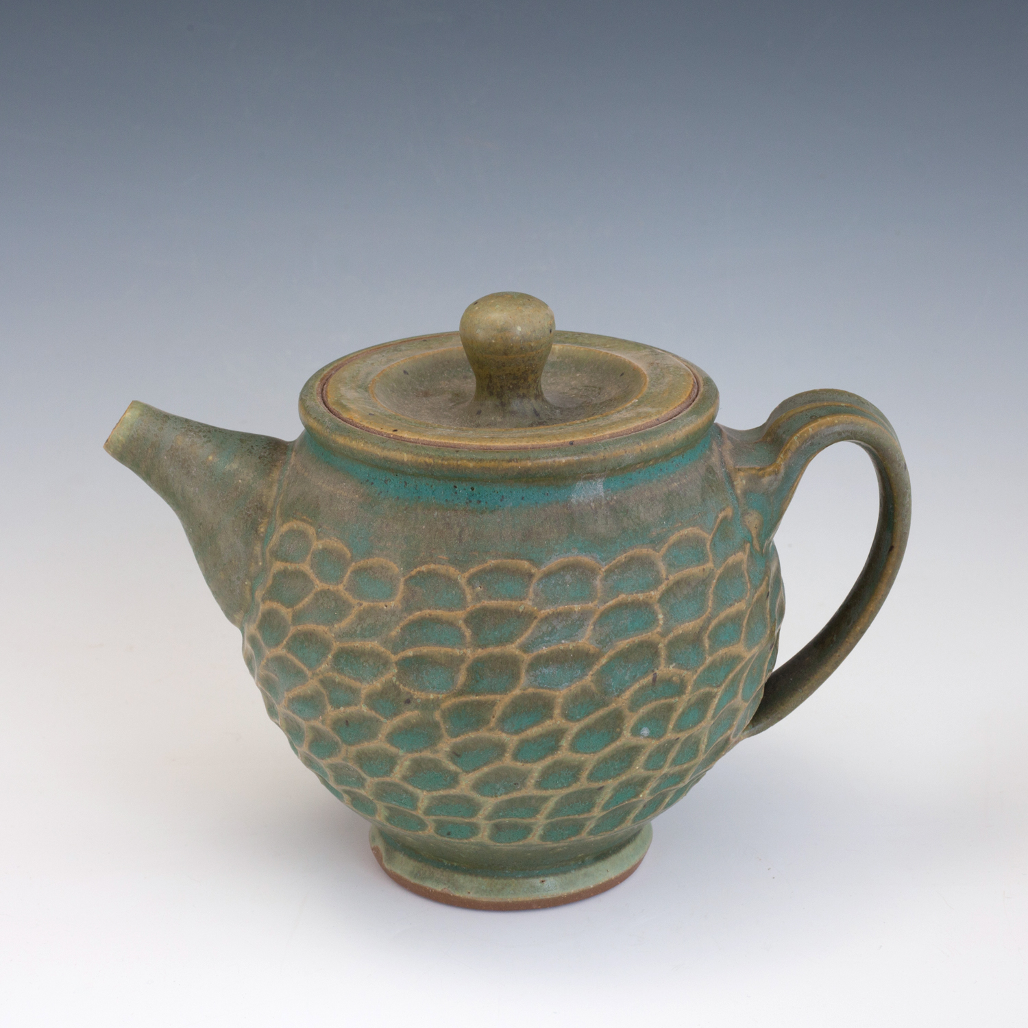 green-carved-teapot